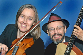 Photo of Ensemble M'chaiya (tm) as a duet – Jutta Distler – violin, Terran Doehrer – guitar. Photo by Wally Reichert. © 2003 Modal Music, Inc. (tm) All rights reserved.