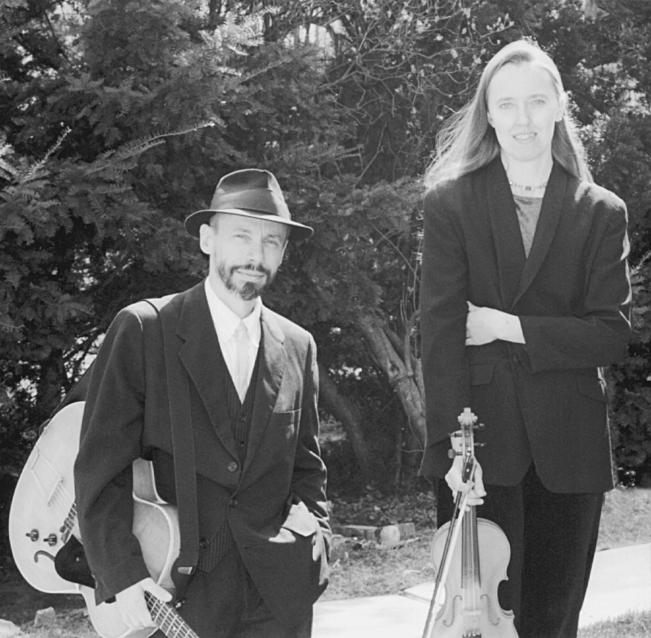 Photo of Ensemble M'chaiya (tm) as a duet – Jutta Distler – violin, Terran Doehrer – guitar. Photo by A. Richardson. © 1999 Modal Music, Inc. (tm) All rights reserved.