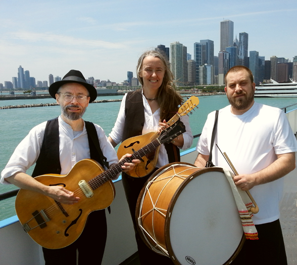 Photo of Ensemble M'chaiya (tm) as a trio – Terran Doehrer, on left – guitar, Jutta Distler, in back – mandolin, Konstantin Marinov, on right – tupan. Photo copyright 2013 Modal Music, Inc. (tm). All rights reserved.
